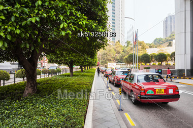 HONG KONG - FEBRUARY 22: Taxis Waiting For Passengers On February 22, 2013 In Hong Kong. Over 90% Of The Daily Journeys Are On Public Transport, Making It The Highest Rate In The World Stock Photo