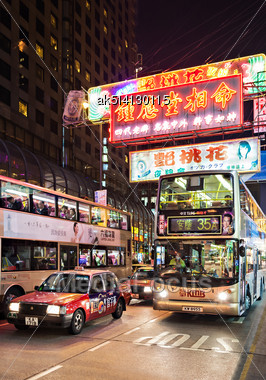 HONG KONG - MARCH 19: Buses On The Street On March 19, 2013 In Hong Kong. Over 90% Travelers In HK Use Public Transport. Its The Highest Rank In The World Stock Photo