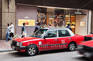 HONG KONG - MARCH 19: Taxis On The Street On March 19, 2013 In Hong Kong. Over 90% Daily Travelers Use Public Transport. Its The Highest Rank In The World Stock Photo