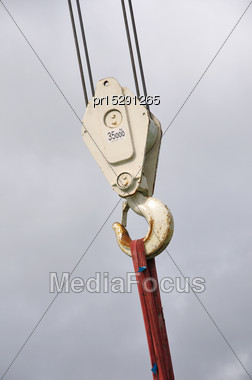 Hook For 35 Tonne Crane Against Cloudy Sky Stock Photo