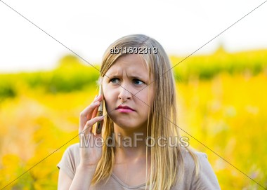 Horizontal Photograph Of Upset Woman Calling On Mobile Phone For Help Because Of Pollen Allergy Outdoors Stock Photo
