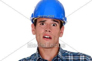 Horrified Tradesman Stock Photo