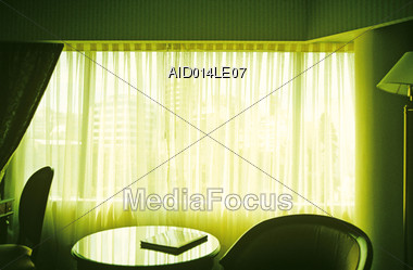 Hotel Room with Backlight Curtains Stock Photo