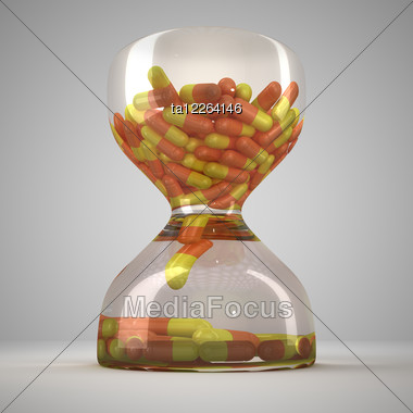 Hourglass With Medical Capsules Stock Image