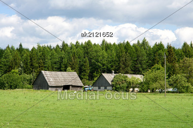 House And Field On A Background Of The Sky Stock Photo