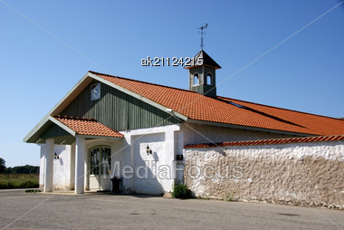 House From A Countryside With A Tower And Hours Stock Photo