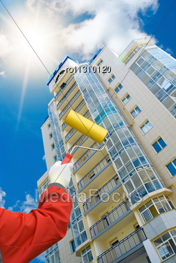 House Painter On Blue Sky Background Stock Photo