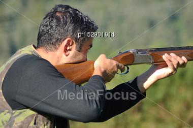 Hunter At The Ready With His Shotgun Stock Photo