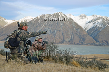 Hunter Looking For Himalayan Tahr In The Southern Alps Of New Zealand Stock Photo