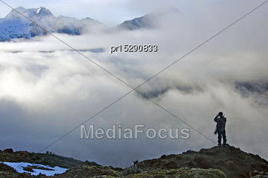 Hunter Scoping For Himalayan Tahr In The Southern Alps Of New Zealand Stock Photo