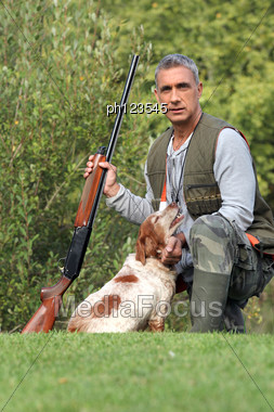 Hunter With Shotgun And Spaniel Stock Photo