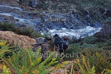 Hunters Drop Down Into A Small Glacier In The Southern Alps, New Zealand Stock Photo