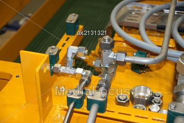 Hydraulic Details On A Yellow Background Stock Photo