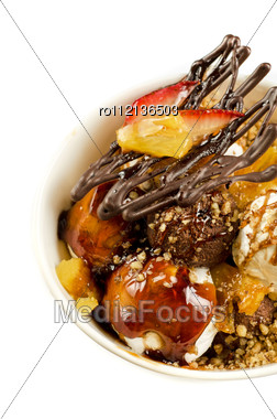 Ice Cream With Chocolate, Nuts And Caramel Close Up Stock Photo