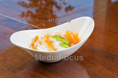 Ice Cream Dessert With Kiwi, Strawberry And Orange Stock Photo