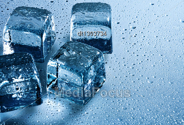 Ice Cube And Water Drops On The Wet Background Stock Photo