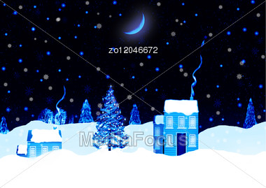 Idyllic Scene In Winter Under A Moonlit Sky Stock Photo
