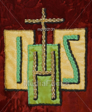 IHS Greek symbol for Jesus on French vestment Stock Photo
