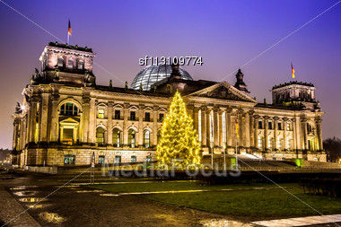 Illuminated Reichstag Building In Berlin, Germany On Christmas Stock Photo
