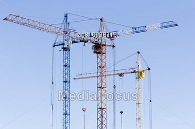 Industrial Landscape With Silhouettes Of Cranes On The Sky Background Stock Photo
