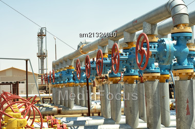 Industrial Valves, Inlet Gas From The Wells To The Plant For Processing Stock Photo