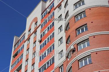 Inhabited High House Against The Blue Sky Stock Photo