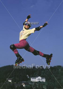 Inline Skater Jumping Stock Photo