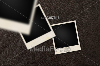 Instant Films On Brown Leather Background Stock Photo