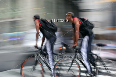 Intentional Motion Blur Abstract Of A Male Bike Riders Moving Along With Traffic Stock Photo