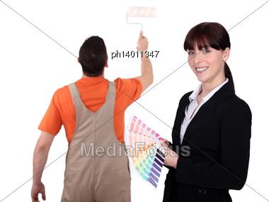 Interior Designer With Painter Stock Photo