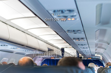 Interior Inside Of The Plane With Passengers Stock Photo