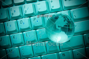 Internet Concept. Crystal-glass Globe On Keyboard Of Notebook Stock Photo