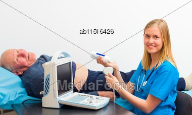 Internist Counsulting Elderly Patient, Preparing For Ultrasound Examination Stock Photo
