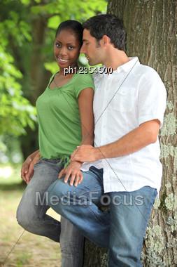 Interracial Couple In A Park. Stock Photo
