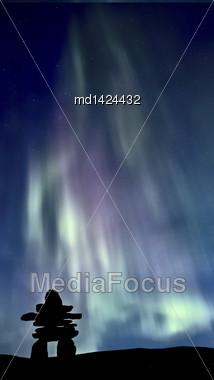 Inukshuk And Northern Lights Saskatchewan Canada Colorful Stock Photo