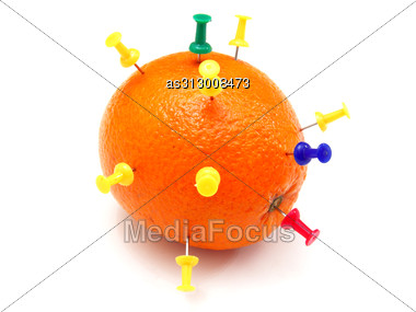 Isolated Colourful Office Pins Thrust In An Orange Stock Photo