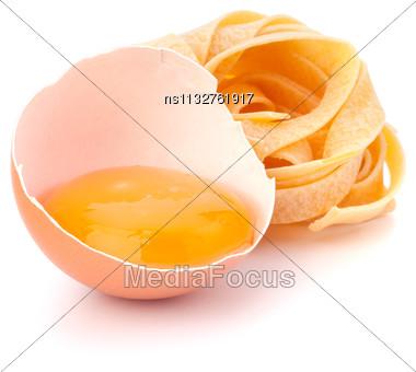 Italian Egg Pasta Fettuccine Nest Isolated On White Background Stock Photo
