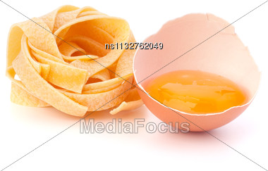 Italian Egg Pasta Fettuccine Nest Isolated On White Background Stock Photo