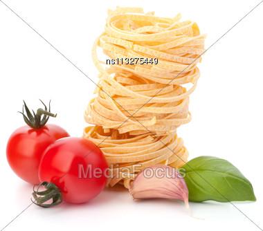 Italian Pasta Tagliatelle Nest And Cherry Tomato Isolated On White Background Stock Photo