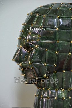 Jade Carving Of Human Head Bound Together With Gold Wire, West Coast, South Island, New Zealand Stock Photo