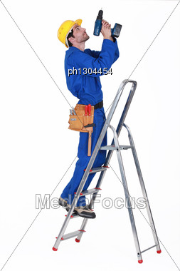 Janitor Piercing The Ceiling. Stock Photo