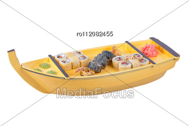 Japanese Cuisine Of Wooden Ship With Various Type Of Sushi On A White Stock Photo