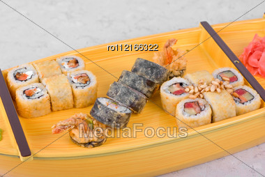 Japanese Food Of Wooden Ship With Various Type Of Sushi Stock Photo