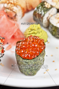 Japanese Sushi Set With Red Caviar Sushi In The Foreground Stock Photo