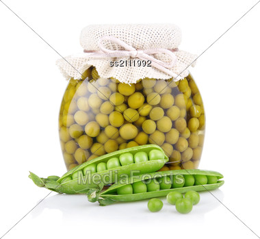 Jar Of Green Pea With Fresh Pods Stock Photo