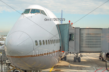 Jet Bridge Docked The Plane At The Airport Stock Photo