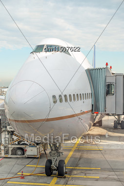 Jet Bridge Docked To The Plane At The Airport Stock Photo
