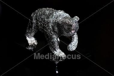 Jewelry Silver Bear Figure On Dark Background Stock Photo