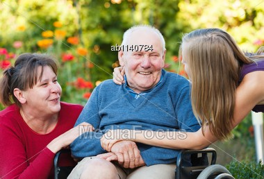 Joyful Family Moment - Loving Grandfather With His Beloved Stock Photo