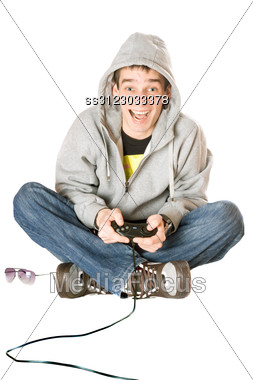 Joyful Guy With A Joystick For Game Console Stock Photo
